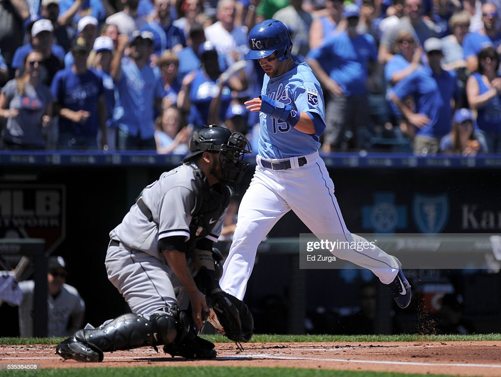 Whit Merrifield #15 of the Kansas City Royals crosses home to score past Dioner Navarro #27 of the Chicago White Sox in the first inning at Kauffman Stadium on May 29, 2016 in Kansas City, Missouri. Merrifield scored on a Lorenzo Cain double.