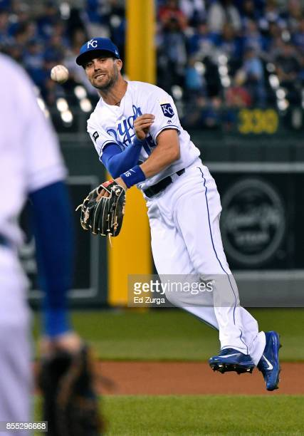 Whit Merrifield of the Kansas City Royals throws to first to get the out on Dixon Machado of the Detroit Tigers in the first inning at Kauffman...