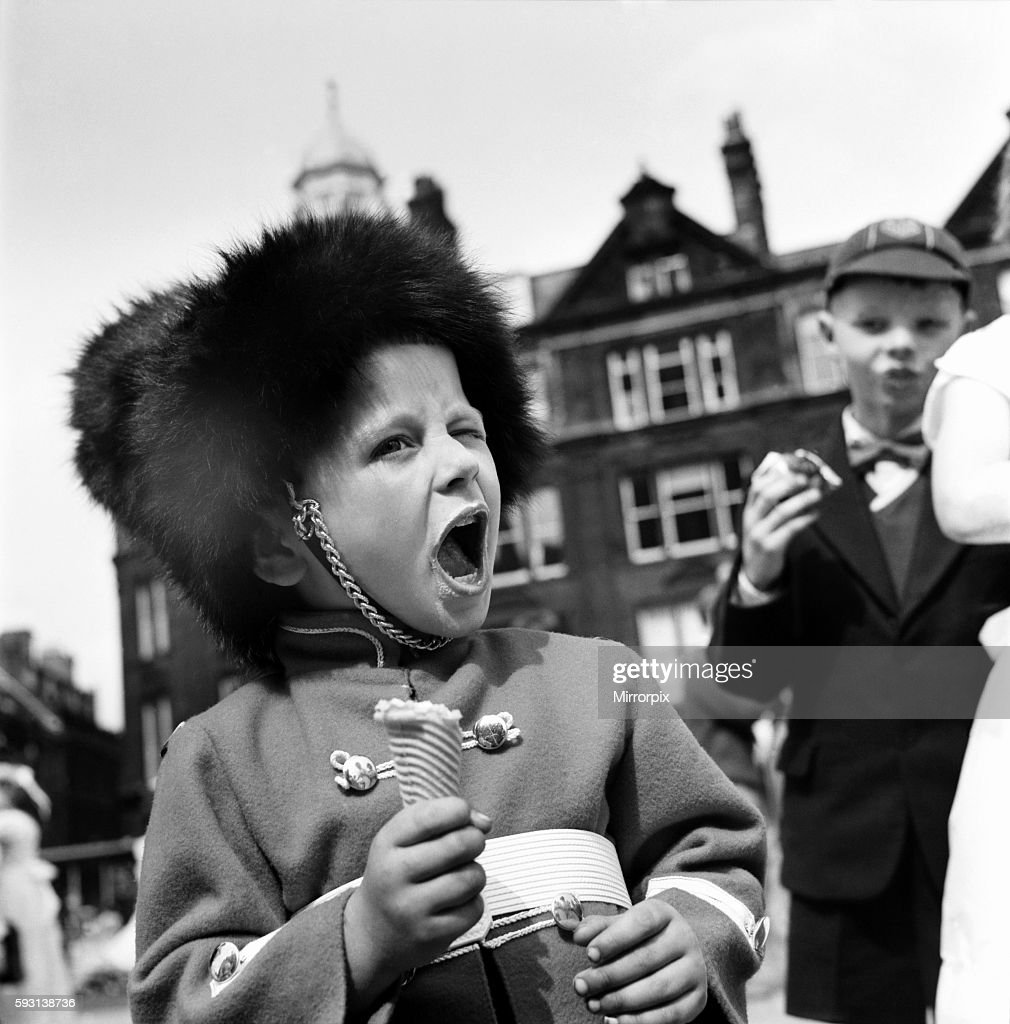 Whit Walks Manchester. June 1960 M4383-012A young boy dressed as a soldier enjoys his Ice cream cone after the Whit Walks in Manchester. June 1960 M4383-012