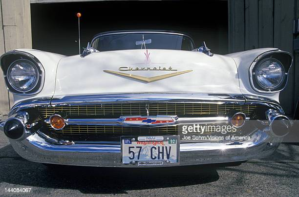 A white 1957 Chevrolet convertible with a Washington license plate reading 57 CHV