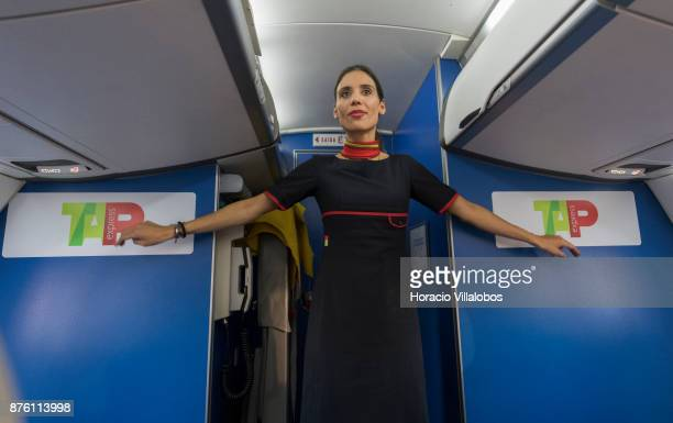 White Airways flight attendant Isabel Fleming shows security procedures on board a ATR 72'u2013600 airplane the company flies for TAP Express in...