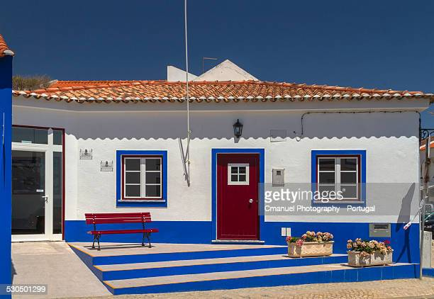 White and blue house with door and windows