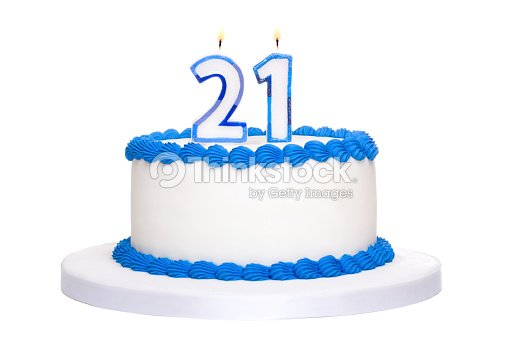 White And Blue Iced Birthday Cake With Twenty One In Candles Stock Photo