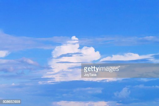 White and brown cloud on blue sky : Stock Photo