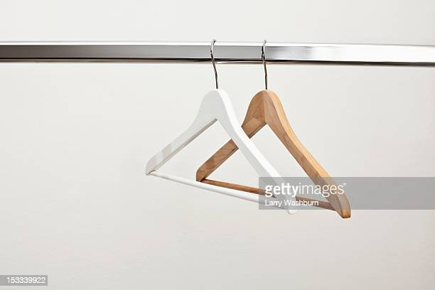 White and brown coat hanger on rail