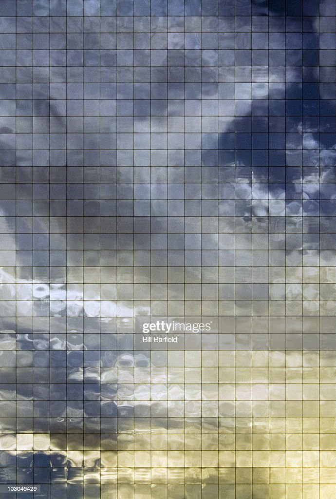 White and gold clouds reflected square windows : Stock Photo