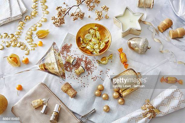 White and gold colored still life with confectionery and variety of objects