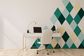 White and green diamond pattern home office with a wooden floor, a square poster, a laptop and a white chair near a computer table. 3d rendering mock up
