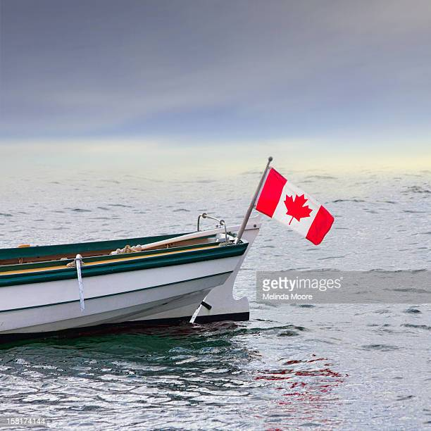 White and green dory with Canadian flag
