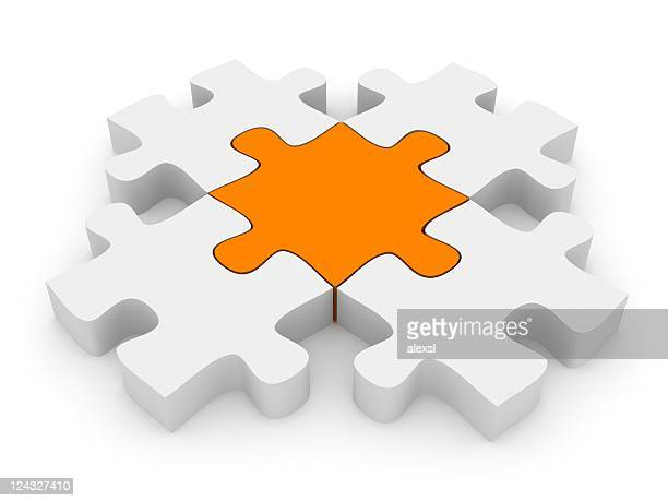 3D white and orange puzzle pieces interlocking