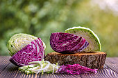 white and red cabbage and  chopped white and red cabbage on wooden background