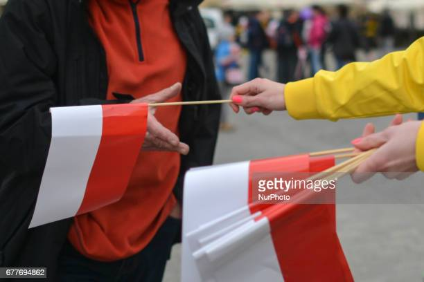 White and red flags distribution on Poland's Flag Day Flag Day was introduced to Poland in 2004 bridging the gap between International Workers' Day...