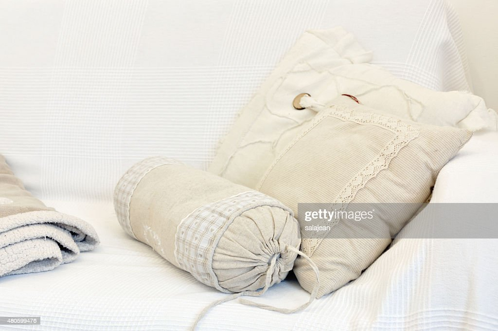 White and yellow pillow on bed : Stock Photo