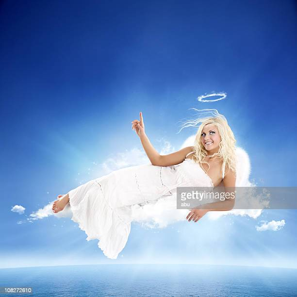 White angel lying on cloud with pointing finger