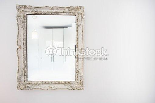 White antique vintage mirror wooden frame on white wall : Stock Photo