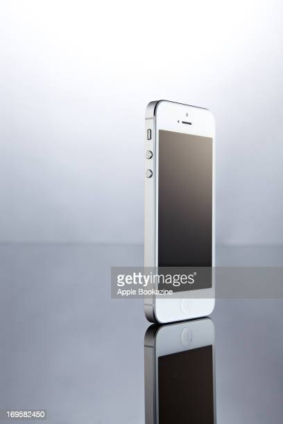 A white Apple iPhone 5 smartphone taken on October 24 2012
