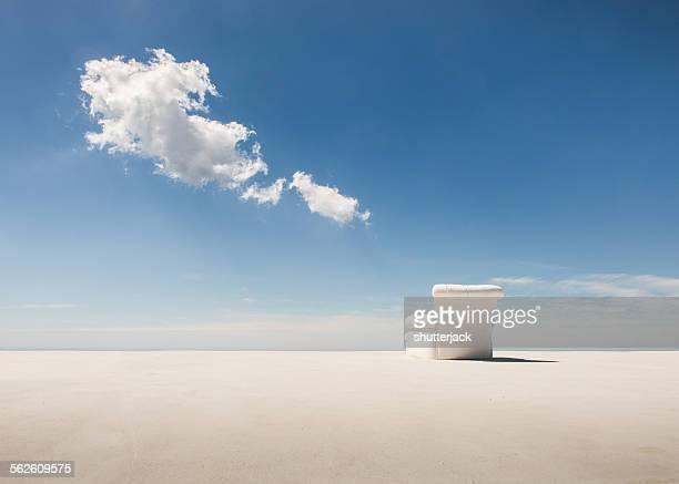 White armchair on the beach
