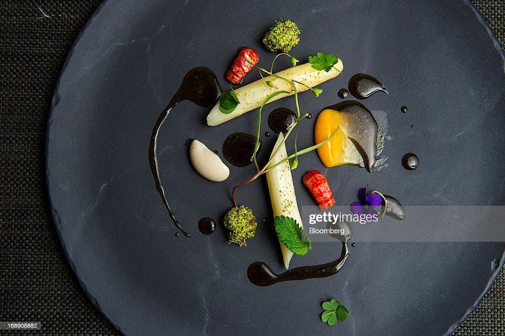 White asparagus, slowly cooked in orange blossom oil, is served at Corton restaurant in New York, U.S., on Friday, May 10, 2013. Corton opened less than a month after Lehman Brothers collapsed in 2008. Photographer: Evan Sung/Bloomberg via Getty Images