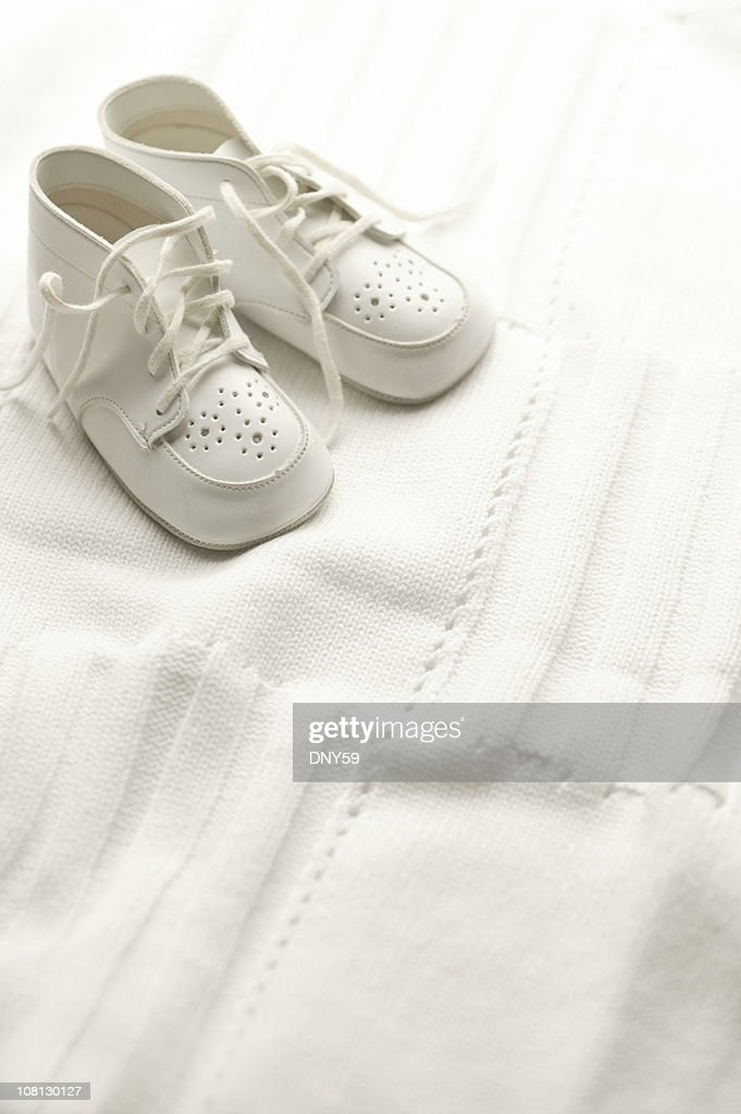 White Baby Shoes on Blanket : Stock Photo