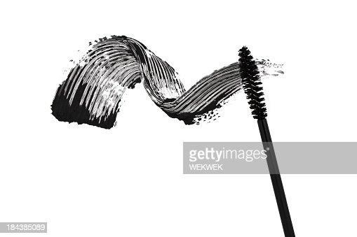 White background with a black mascara smear