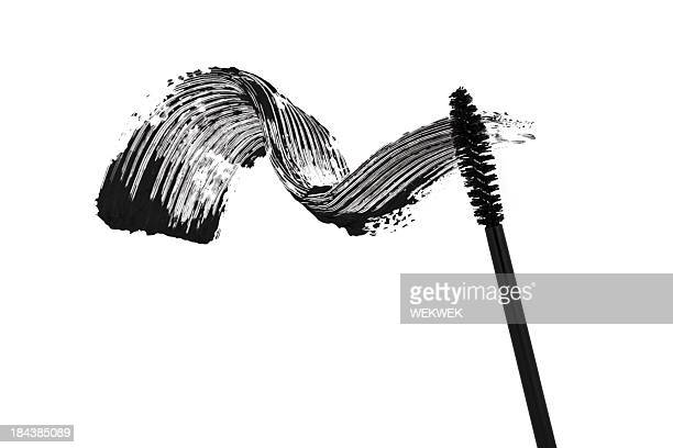 White background with a black mascara smear
