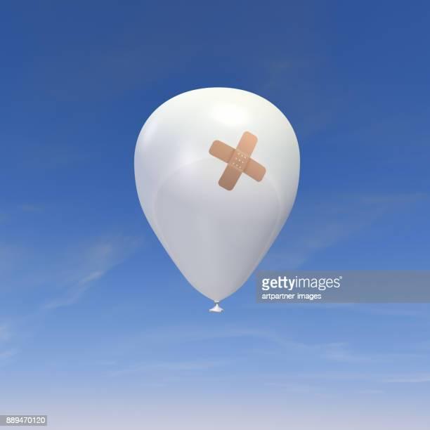 white balloon with adhesive bandage
