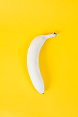 'na white banana on a yellow background. Colors have been reversed.'nFun, minimal and quirky color still life photography