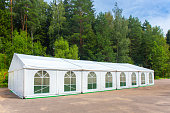 White banquet tent assembled and ready for use
