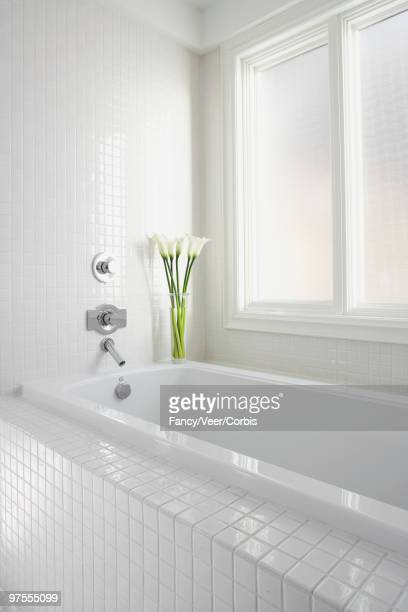 White bathroom with calla lilies