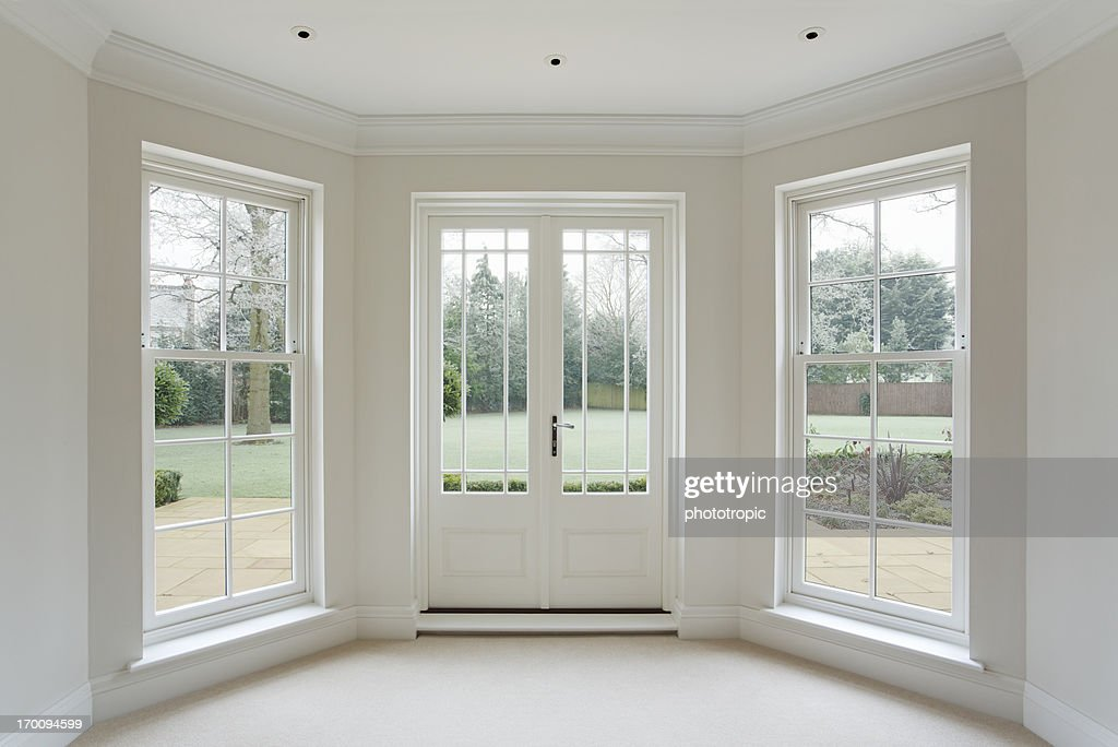 French Doors And Windows : White bay windows and french doors stock photo getty images