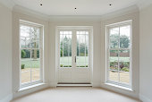white bay windows and French doors