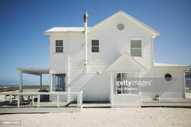 White beach house against blue sky