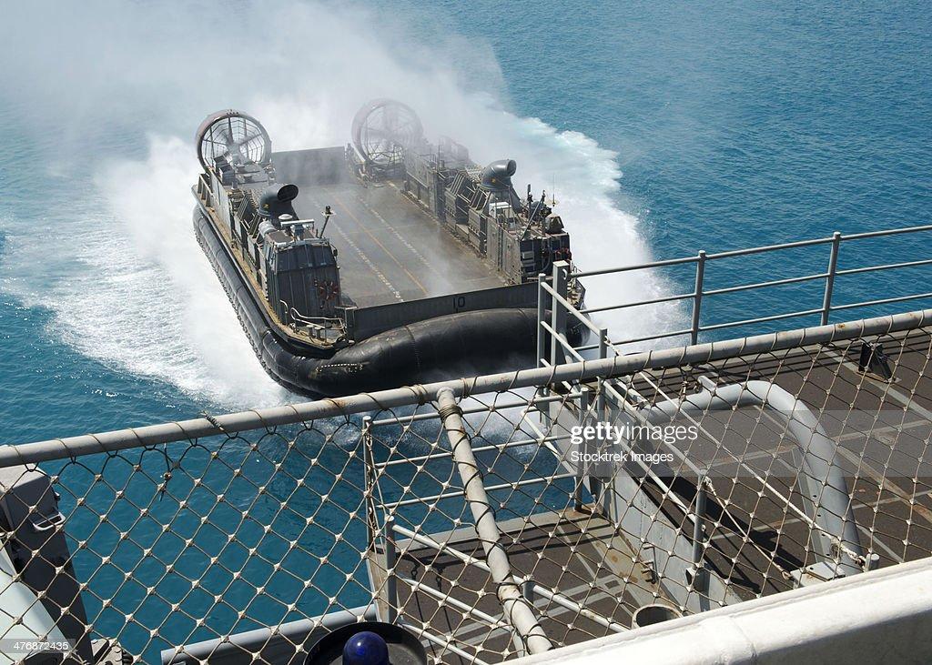 White Beach, Japan, September 25, 2013 - A landing craft air cushion approaches the well deck of the amphibious assault ship USS Bonhomme Richard.