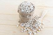 white bean in hemp sack on sack background