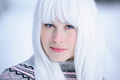 woman with white hair and blue eyes.