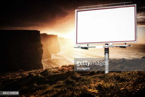White billboard and cliffs of Moher at sunset : Stock Photo