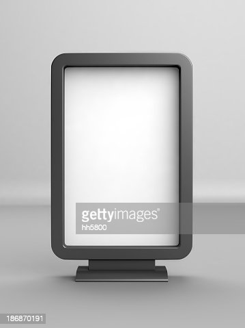 A white blank advertising board with black borders and stand
