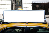 White blank billboard on the taxi roof. Yellow cab in New York City.