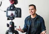 White blogger recording video