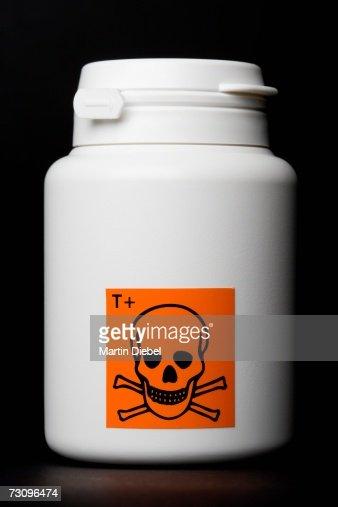 White bottle with toxic warning label