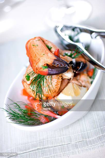 White bowl filled with crab claws