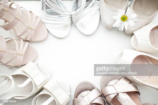 White bridesmaid and wedding shoes in a circle