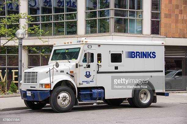 White Brinks armored security truck parked in front of a building