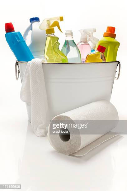 A white bucket full of cleaning products