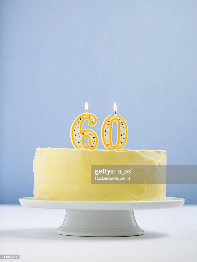 white cake on a platter with candles. : Stock Photo
