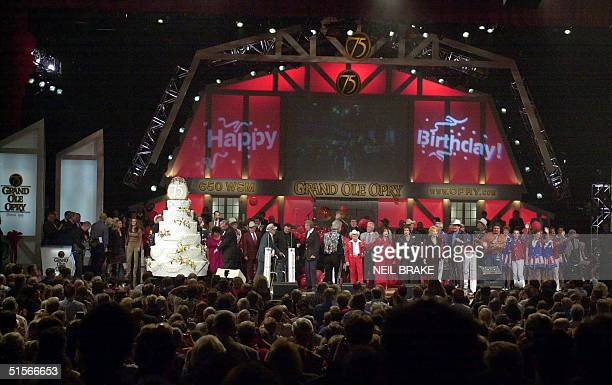 A white cake sits on stage to celebrate the 75th Birthday of the Grand Ole Opry in Nashville Tennessee 14 October 2000 Several country music stars...