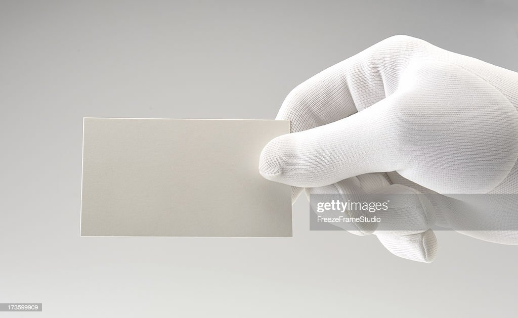 White card/white gloved hand/copy space