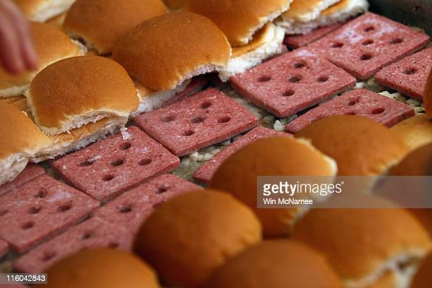 White Castle employees cook their slider burgers before delivering them at the US Capitol to celebrate the company's 90th anniversary with a 'Castles...
