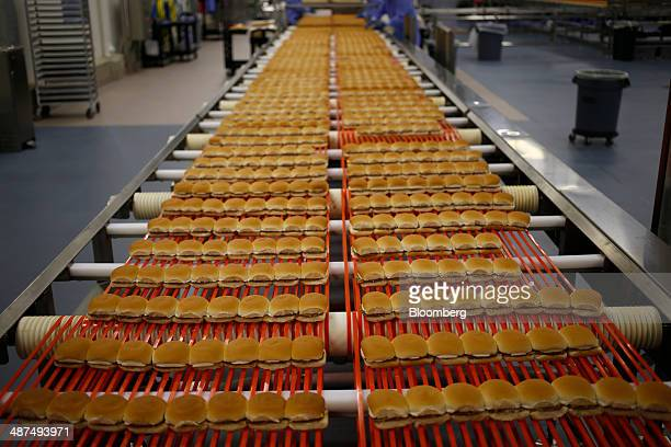 White Castle hamburger Sliders move down a conveyor belt before being frozen packaged and shipped to grocery stores at the new White Castle Co...
