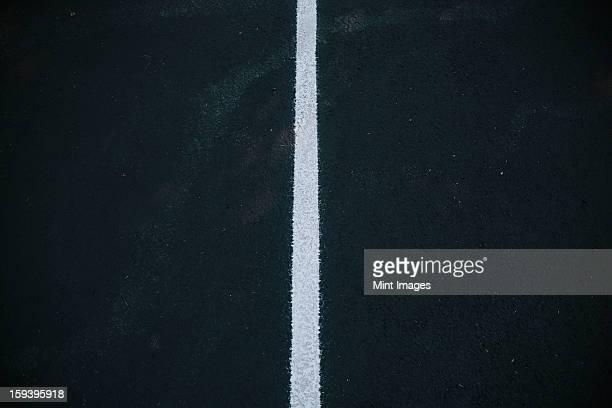 White center line on a black asphalt surface.